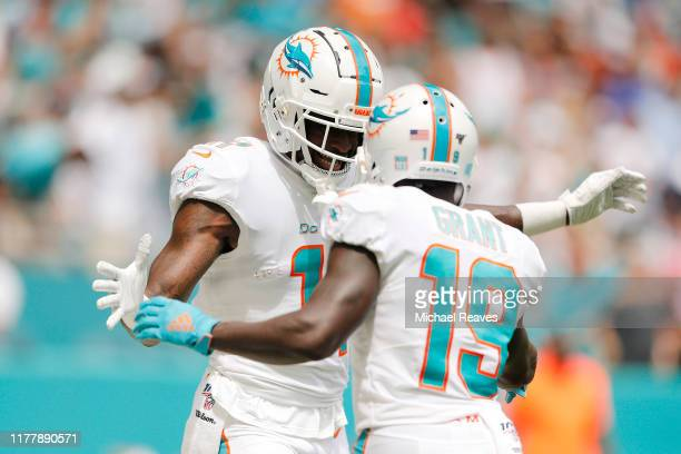 DeVante Parker of the Miami Dolphins celebrates with Jakeem Grant after a touchdown reception against the Los Angeles Chargers during the first...