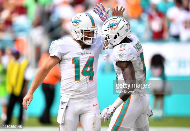 DeVante Parker of the Miami Dolphins celebrates with Ryan Fitzpatrick aftewr scoring a touchdown against the Washington Redskins in the fourth...
