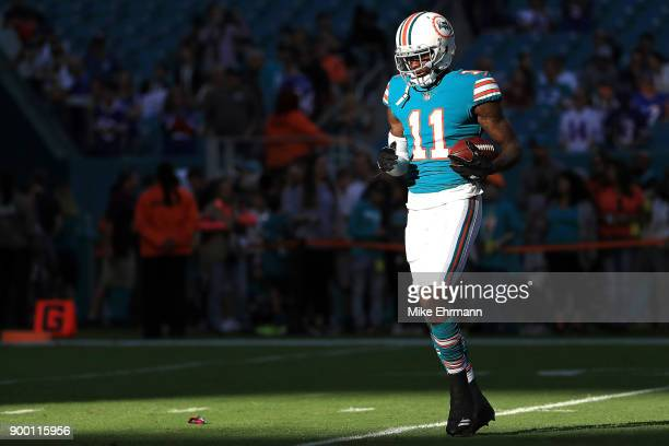 DeVante Parker of the Miami Dolphins during pregame against the Buffalo Bills at Hard Rock Stadium on December 31 2017 in Miami Gardens Florida