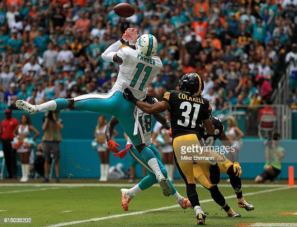 DeVante Parker of the Miami Dolphins has a pass broken up by Ross Cockrell of the Pittsburgh Steelers during a game on October 16 2016 in Miami...
