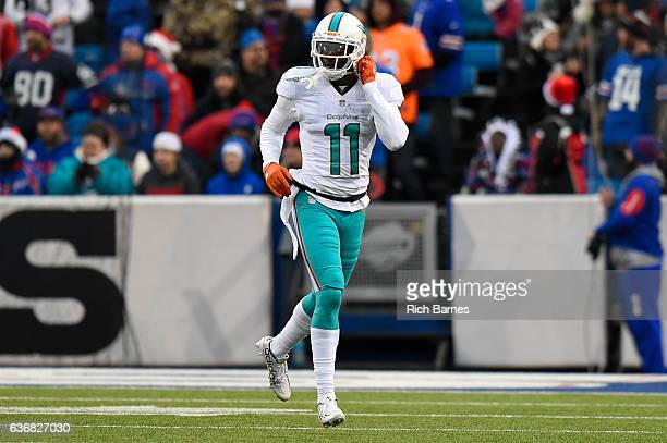DeVante Parker of the Miami Dolphins jogs off the field following his touchdown catch and run against the Buffalo Bills during the third quarter at...