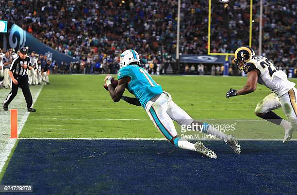 DeVante Parker of the Miami Dolphins makes nine yard touchdown catch from quarterback Ryan Tannehill late in the fourth quarter of the game against...