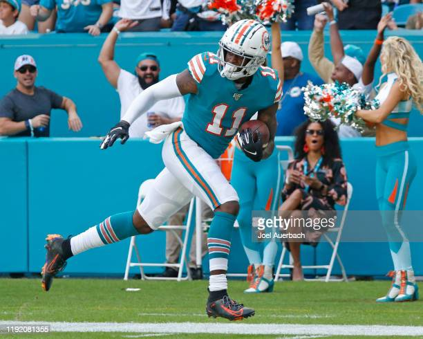 DeVante Parker of the Miami Dolphins runs for a touchdown against the Philadelphia Eagles during an NFL game on December 1 2019 at Hard Rock Stadium...