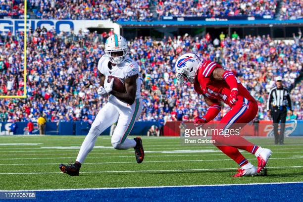 DeVante Parker of the Miami Dolphins runs into the end zone on a touchdown reception during the second quarter against the Buffalo Bills at New Era...