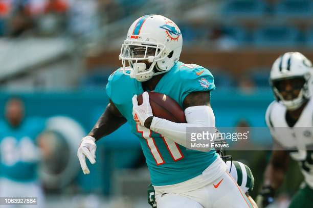 DeVante Parker of the Miami Dolphins runs with the ball after a reception against the New York Jets at Hard Rock Stadium on November 4 2018 in Miami...