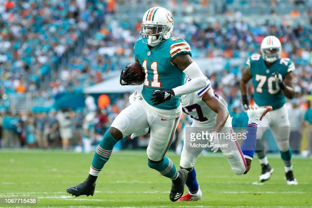 DeVante Parker of the Miami Dolphins runs with the ball after a reception against the Buffalo Bills during the first half at Hard Rock Stadium on...