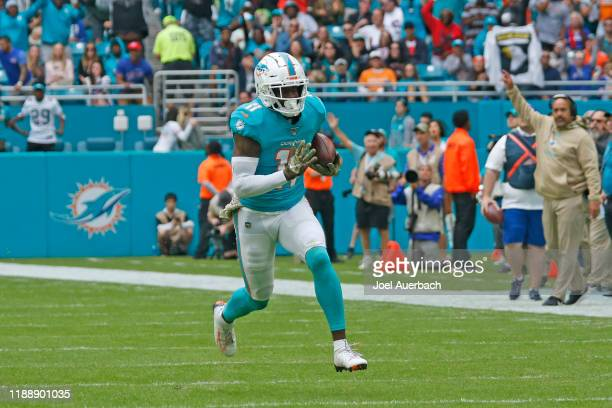 DeVante Parker of the Miami Dolphins runs with the ball against the Buffalo Bills during an NFL game on November 17, 2019 at Hard Rock Stadium in...