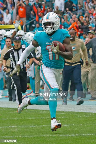 DeVante Parker of the Miami Dolphins runs with the ball against the Buffalo Bills during an NFL game on November 17 2019 at Hard Rock Stadium in...