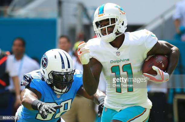 DeVante Parker of the Miami Dolphins tries to avoid the tackle of Brian Orakpo of the Tennessee Titans in the first quarter on October 8 2017 at Hard...