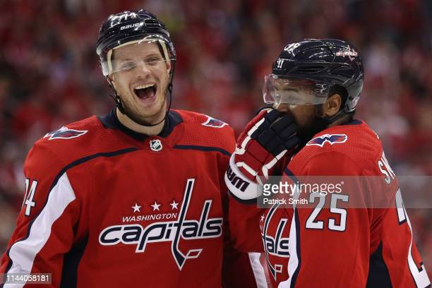Devante SmithPelly and John Carlson of the Washington Capitals share a laugh against the Carolina Hurricanes in the third period in Game Five of the...