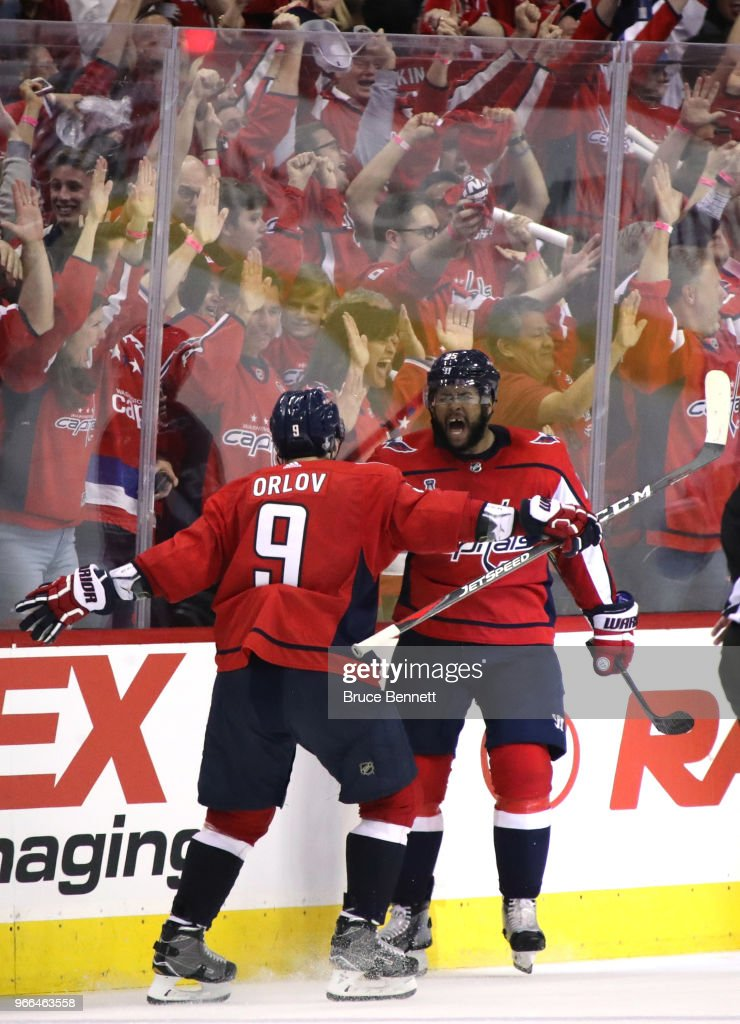 Devante Smith-Pelly #25 is congratulated by his teammate Dmitry Orlov #9 after scoring a third-period goal against the Vegas Golden Knights in Game Three of the 2018 NHL Stanley Cup Final at Capital One Arena on June 2, 2018 in Washington, DC.