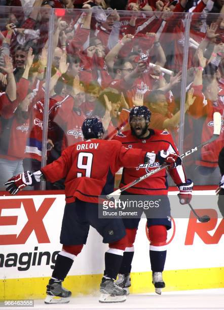 Devante SmithPelly is congratulated by his teammate Dmitry Orlov after scoring a thirdperiod goal against the Vegas Golden Knights in Game Three of...