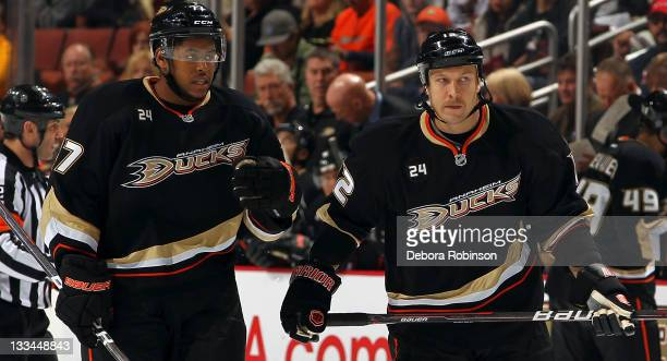 Devante SmithPelly of the Anaheim Ducks and Niklas Hagman of the Anaheim Ducks skate on the ice during a break in action in the game against the Los...