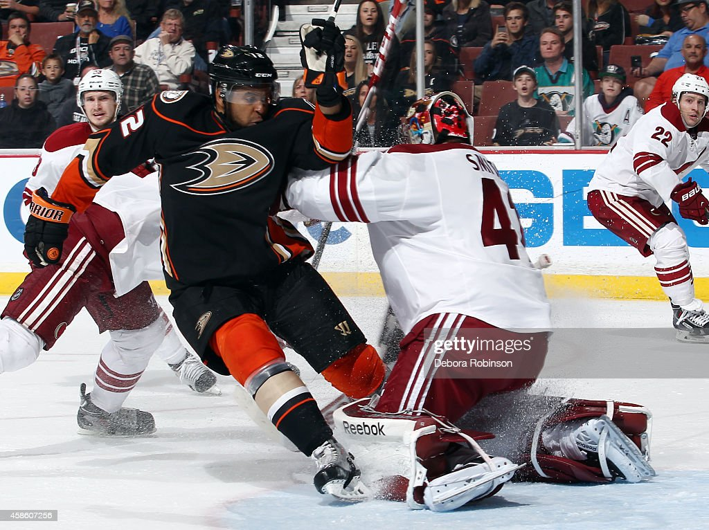 Devante Smith-Pelly #12 of the Anaheim Ducks collides into Mike Smith #41 of the Arizona Coyotes on November 7, 2014 at Honda Center in Anaheim, California.