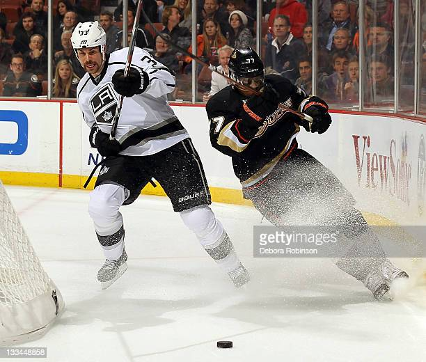 Devante SmithPelly of the Anaheim Ducks races for the puck behind the net against Willie Mitchell of the Los Angeles Kings during the game on...