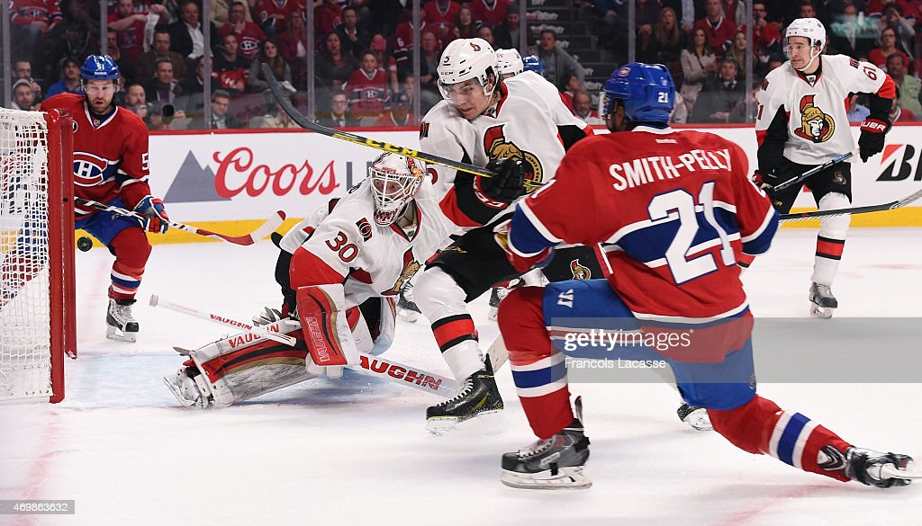 Devante Smith-Pelly of the Montreal Canadiens takes a shot on goal Andrew Hammond #30 of Ottawa Senators in Game One of the Eastern Conference Quarterfinals during the 2015 NHL Stanley Cup Playoffs at the Bell Centre on April 15, 2015 in Montreal, Quebec, Canada.