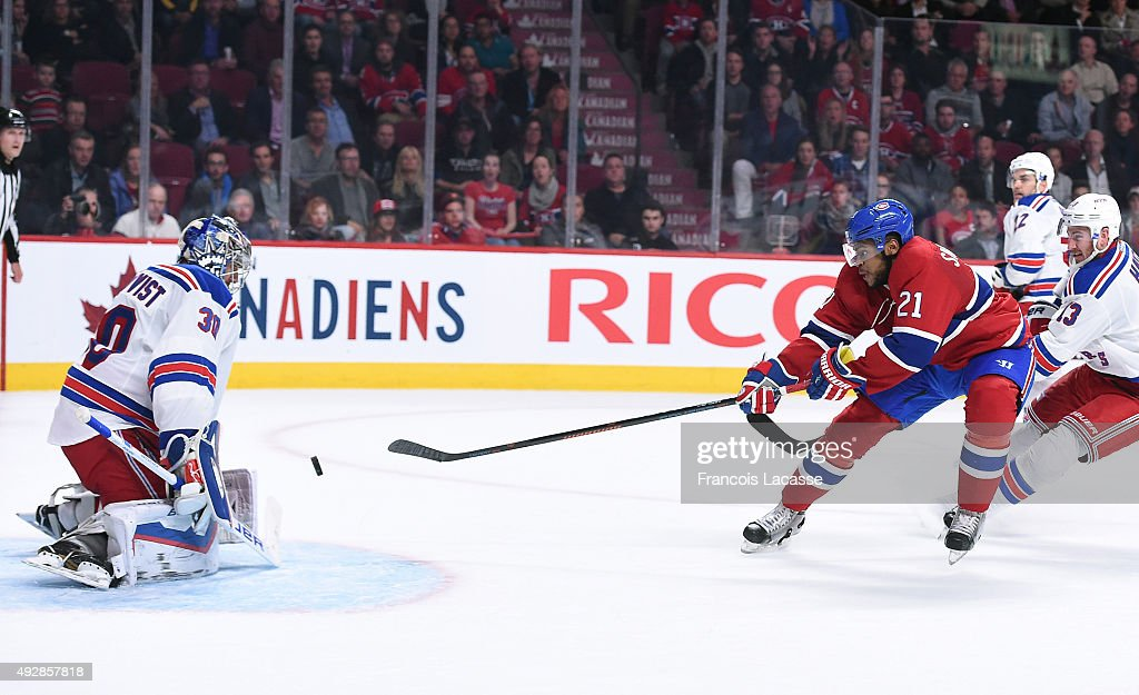 Devante Smith-Pelly #21 of the Montreal Canadiens takes a shot on Henrik Lundqvist #30 of the New York Rangers in the NHL game at the Bell Centre on October 15, 2015 in Montreal, Quebec, Canada.