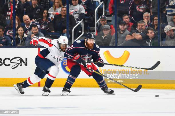 Devante SmithPelly of the Washington Capitals and Ian Cole of the Columbus Blue Jackets battle for position as they skate after a loose puck during...