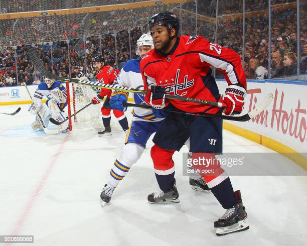 Devante SmithPelly of the Washington Capitals and Jacob Josefson of the Buffalo Sabres battle for position during an NHL game on February 19 2018 at...