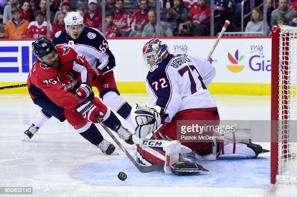 Devante SmithPelly of the Washington Capitals and Sergei Bobrovsky of the Columbus Blue Jackets collide in the third period in Game Five of the...
