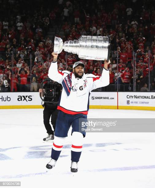 Devante SmithPelly of the Washington Capitals carries the Stanley Cup in celebration after his team defeated the Vegas Golden Knights 43 in Game Five...