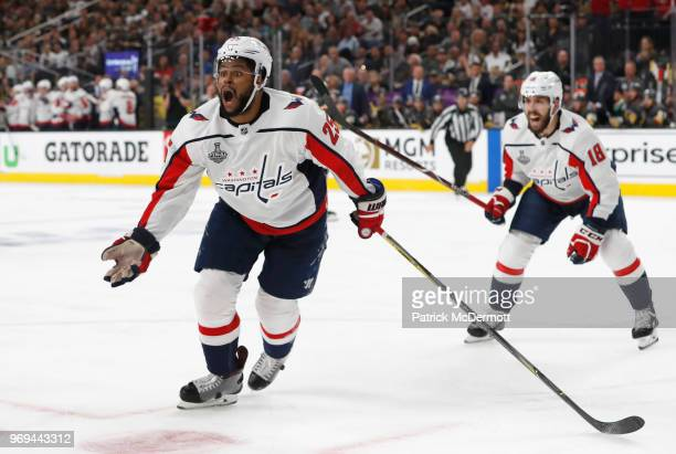 Devante SmithPelly of the Washington Capitals celebrates his goal to tie the game with teammate Chandler Stephenson during the third period of Game...
