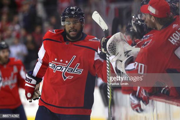 Devante SmithPelly of the Washington Capitals celebrates with teammates after scoring a goal against the San Jose Sharks during the first period at...
