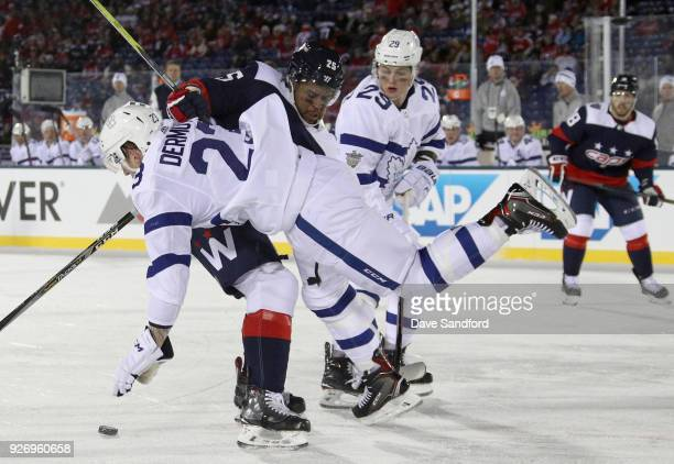Devante SmithPelly of the Washington Capitals collides with Travis Dermott of the Toronto Maple Leafs during the third period of the 2018 Coors Light...