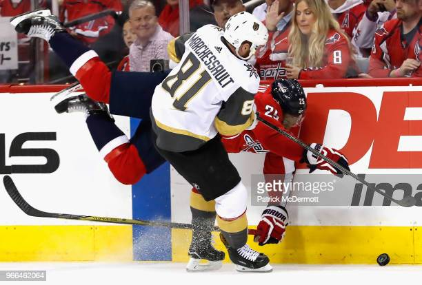 Devante SmithPelly of the Washington Capitals falls along the boards against Jonathan Marchessault of the Vegas Golden Knights during the second...