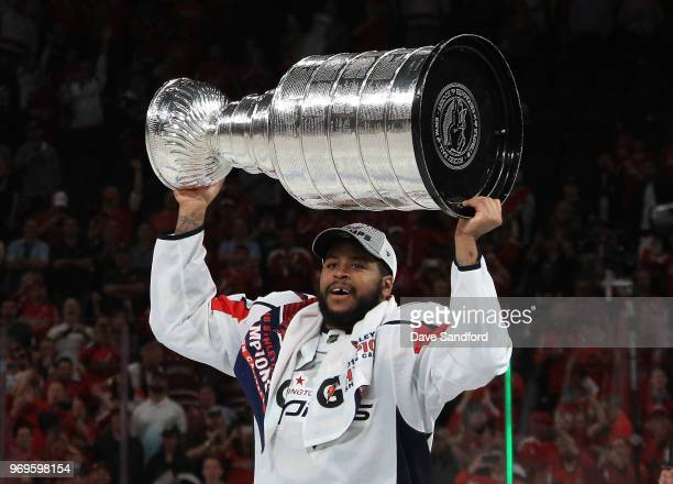 Devante SmithPelly of the Washington Capitals hoists the Stanley Cup after Game Five of the 2018 NHL Stanley Cup Final between the Washington...
