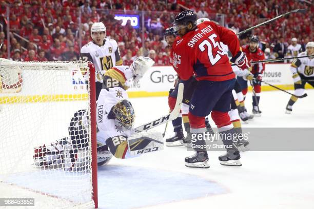 Devante SmithPelly of the Washington Capitals is called for goalie interference against MarcAndre Fleury of the Vegas Golden Knights during the first...