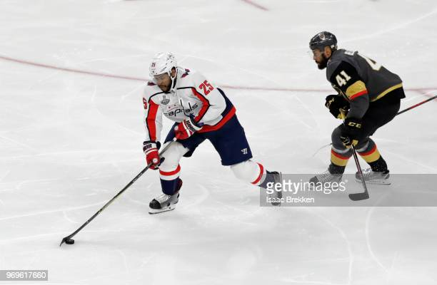 Devante SmithPelly of the Washington Capitals is pursued by PierreEdouard Bellemare of the Vegas Golden Knights during the first period in Game Five...