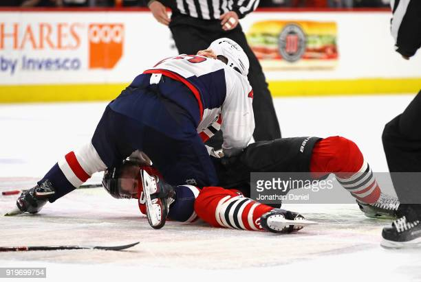 Devante SmithPelly of the Washington Capitals jumps on Connor Murphy of the Chicago Blackhawks at the United Center on February 17 2018 in Chicago...