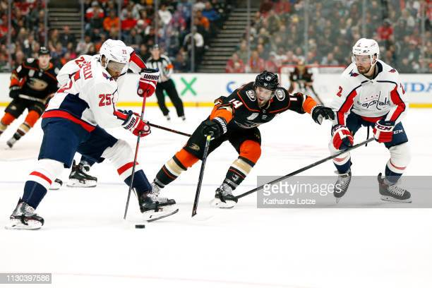 Devante SmithPelly of the Washington Capitals looks to pass as Adam Henrique of the Anaheim Ducks looks to steal the puck during the first period at...