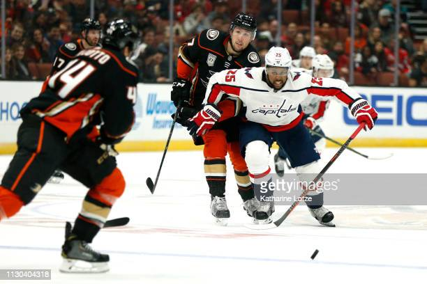 Devante SmithPelly of the Washington Capitals pushes past Nick Ritchie of the Anaheim Ducks during the second period at Honda Center on February 17...