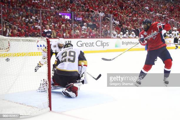 Devante SmithPelly of the Washington Capitals scores a goal past MarcAndre Fleury of the Vegas Golden Knights during the third period in Game Three...