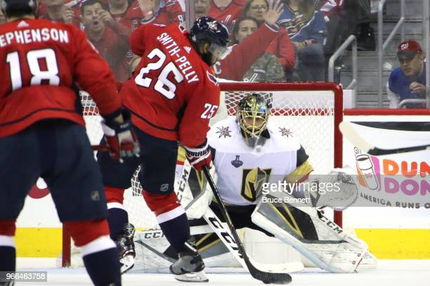 Devante SmithPelly of the Washington Capitals scores a thirdperiod goal past MarcAndre Fleury of the Vegas Golden Knights in Game Three of the 2018...