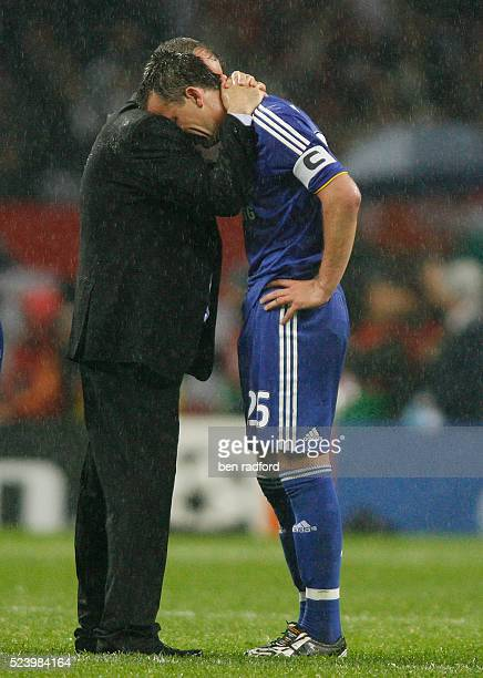A devastated John Terry of Chelsea cries on the shoulder of Manager Avram Grant during the UEFA Champions League Final between Chelsea and Manchester...