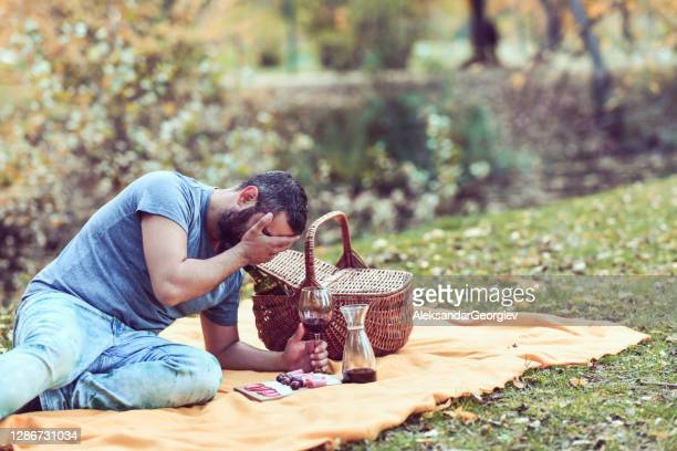 devastated male crying after being ditched during picnic date - mexican picnic stock pictures, royalty-free photos & images