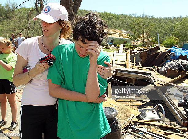 A devastating tornado moved though the town of Monson on Wednesday June 1 causing widespread destruction Joey Yarbrough cries as he is hugged by...