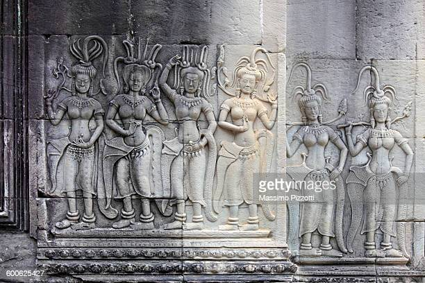 devatas bas-relief on angkor wat - bas relief stock pictures, royalty-free photos & images