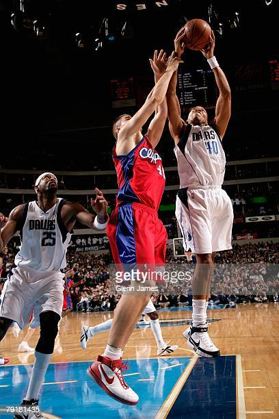 Devean George of the Dallas Mavericks grabs a rebound over Paul Davis of the Los Angeles Clippers during the game on December 21 2007 at American...