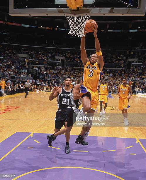 Devean George of the Los Angeles Lakers dunks the ball during the NBA game against the San Antonio Spurs at Staples Center on October 29 2002 in Los...