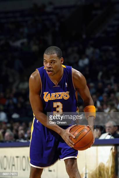 Devean George of the Los Angeles Lakers holds the ball against the Milwaukee Bucks on December 6 2005 at the Bradley Center in Milwaukee Wisconsin...