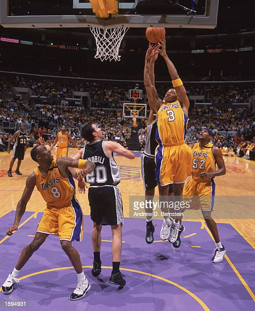 Devean George of the Los Angeles Lakers leaps for a rebound during the NBA game against the San Antonio Spurs at Staples Center on October 29 2002 in...