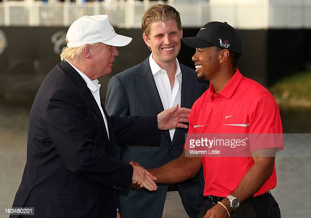 Developer Donald Trump greets Tiger Woods after the final round of the World Golf ChampionshipsCadillac Championship as Eric Trump looks on at the...