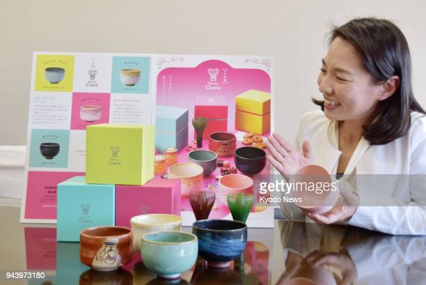 A developer shows off a kit of bowls and tea serving tools called Matsue Chatte in Matsue western Japan on March 28 2018 The kit went on sale to...