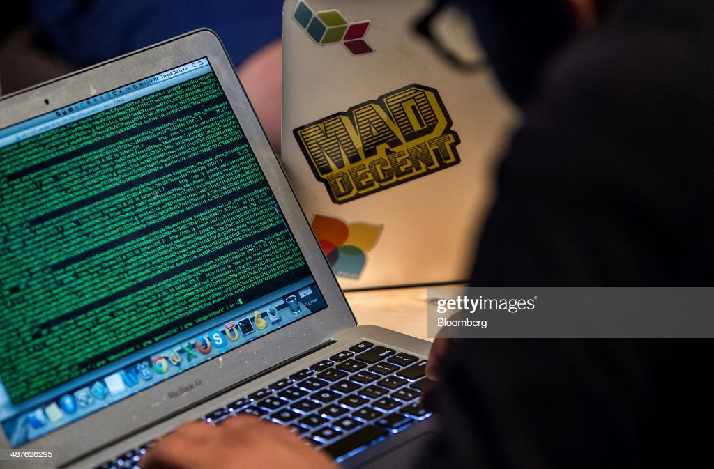 A developer works on code during the Facebook F8 Developers Conference in San Francisco, California, U.S., on Wednesday, April 30, 2014. Facebook will offer software developers improved tools to create programs that run on any smartphone and a more streamlined experience for people to log into apps, including the option to sign in anonymously. Photographer: Erin Lubin/Bloomberg via Getty Images