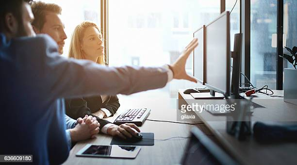 developers at work. - information technology support stock photos and pictures