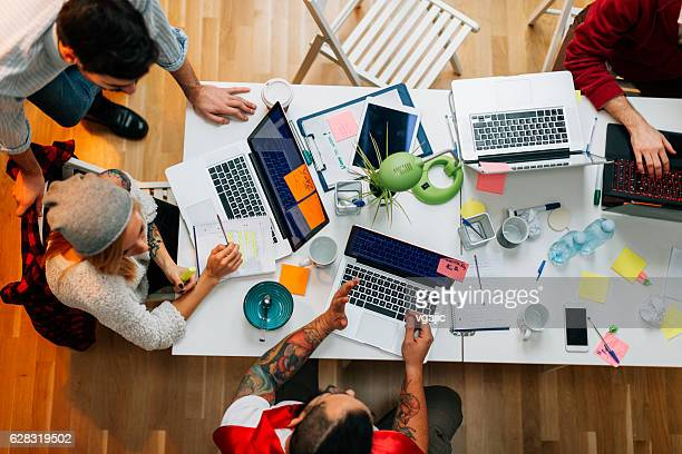 developers working in their office. - en:creative stock pictures, royalty-free photos & images